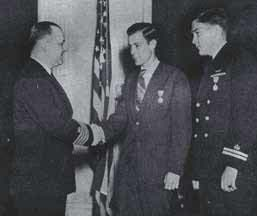 Charles D. Tucker and Frank W. Carey, Jr.are awarded medals